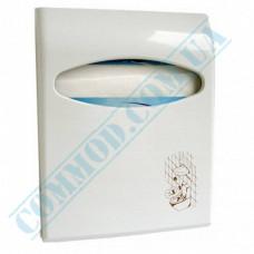 Dispenser for sanitary pads on the toilet bowl 1/4-fold plastic article 662 Mar Plast (Italy)